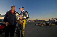Nov. 2, 2008; Las Vegas, NV, USA: NHRA top fuel dragster driver Tony Schumacher (right) celebrates with father and team owner Don Schumacher after winning the Las Vegas Nationals at The Strip in Las Vegas. Mandatory Credit: Mark J. Rebilas-
