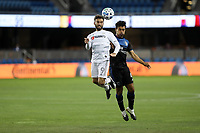 SAN JOSE, CA - NOVEMBER 4: Diego Rossi #9 of LAFC goes up for a header with Oswaldo Alanis #4 of the San Jose Earthquakes during a game between Los Angeles FC and San Jose Earthquakes at Earthquakes Stadium on November 4, 2020 in San Jose, California.