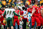 Illinois State Redbirds offensive lineman Dan Pawlak (76) and North Dakota State Bison defensive end D'Andre Gillins (99) in action during the FCS Championship game between the North Dakota State Bison and the Illinois State Redbirds at the Toyota Stadium in Frisco, Texas. North Dakota defeats Illinois 29 to 27.