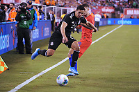 EAST RUTHERFORD, NJ - SEPTEMBER 7: Jorge Sanchez #21 of Mexico battles for the ball with Christian Pulisic #10 of the United States during a game between Mexico and USMNT at MetLife Stadium on September 6, 2019 in East Rutherford, New Jersey.