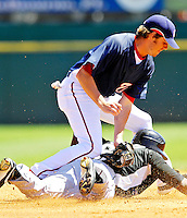 18 March 2007: Washington Nationals infielder Josh Wilson attempts a tag at second  against the Florida Marlins at Space Coast Stadium in Viera, Florida...Mandatory Photo Credit: Ed Wolfstein Photo