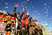 Nov. 6, 2010; Las Vegas, NV USA; LOORRS pro two unlimited driver Robby Woods (left), Carl Renezeder (center) and Rodrigo Ampudia celebrate on the podium following round 13 at the Las Vegas Motor Speedway short course. Mandatory Credit: Mark J. Rebilas-US PRESSWIRE