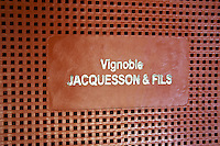 A plastic crate that is used to put the grapes in when harvesting, stamped with the winery's name, Champagne Jacquesson in Dizy, Vallee de la Marne, Champagne, Marne, Ardennes, France, low light grainy grain