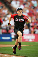 Macklemore runs to first base during the All-Star Legends and Celebrity Softball Game on July 12, 2015 at Great American Ball Park in Cincinnati, Ohio.  (Mike Janes/Four Seam Images)