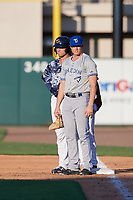 Dunedin Blue Jays first baseman Kacy Clemens (21) and his brother Kody Clemens (8) during a Florida State League game against the Lakeland Flying Tigers on May 18, 2019 at Publix Field at Joker Marchant Stadium in Lakeland, Florida.  Dunedin defeated Lakeland 3-2 in eleven innings.  (Mike Janes/Four Seam Images)
