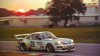The #59 Porsche of Hurley Haywood, Walter Röhrl, and <br /> Hans Joachim Stuck races at sunset en route to an 11th place finish, 12 Hours of Sebring, Sebring International Raceway, Sebring , FL, March 19, 1994. (Photo by Brian Cleary/www.bcpix.com)