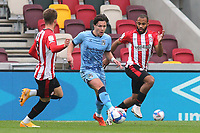 Coventry's Callum O'Hare in possession as Brentford's Mathias Jensen and Bryan Mbeumo look on during Brentford vs Coventry City, Sky Bet EFL Championship Football at the Brentford Community Stadium on 17th October 2020