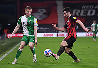 12th January 2021; Vitality Stadium, Bournemouth, Dorset, England; English Football League Championship Football, Bournemouth Athletic versus Millwall; Lewis Cook of Bournemouth competes for the ball with Jon Dadi Bodvarsson of Millwall