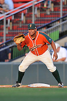 First baseman Josh Naylor (10) of the Greensboro Grasshoppers plays defense in a game against the Greenville Drive on Thursday, July 14, 2016, at Fluor Field at the West End in Greenville, South Carolina. (Tom Priddy/Four Seam Images)