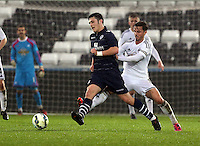 Pictured: Swansea captain Henry Jones (R) Monday 30 March 2015<br />