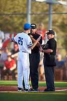 South Dakota State Jackrabbits head coach Rob Bishop (26) questions a call with umpires Kyle Reese and Mark Spicer during a game against the Northeastern Huskies on February 23, 2019 at North Charlotte Regional Park in Port Charlotte, Florida.  Northeastern defeated South Dakota State 12-9.  (Mike Janes/Four Seam Images)