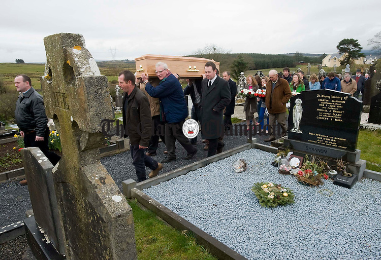 The coffin of Joe Ryan is carried through to the local graveyard for burial following his funeral mass in Inagh church. Photograph by John Kelly.