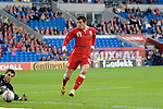 Gareth Bale tests the Norway goalie during the Wales v Norway Vauxhall international friendly match at the Cardiff City Stadium in South Wales..Editorial use only.