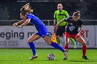 Gent's forward Lobke Loonen (19) and Woluwe's forward Stephanie Suenens (17) pictured during a female soccer game between  AA Gent Ladies and Femina White Star Woluwe on the third matchday of the 2020 - 2021 season of Belgian Scooore Womens Super League , friday 2 nd of October 2020  in Oostakker , Belgium . PHOTO SPORTPIX.BE | SPP | STIJN AUDOOREN