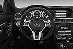 Steering wheel view of a 2013 Mercedes C-Class C63 AMG Sedan Stock Photo