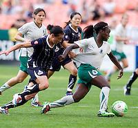 Sarah Huffman, Eniola Aluko. The Washington Freedom defeated the Saint Louis Athletica, 3-1.