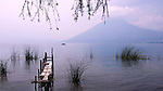 View of Volcano San Pedro from San Marcos La Laguna with lancha in the distance on Lake Atitlan, Guatemala