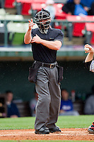 Home plate umpire Toby Basner makes a strike call during the International League game between the Buffalo Bison and the Charlotte Knights at Knights Stadium on May 13, 2012 in Fort Mill, South Carolina.  The Bison defeated the Knights 7-6.  (Brian Westerholt/Four Seam Images)