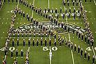 Sept 13, 2014; The Notre Dame Marching Band performs in Lucas Oil Stadium before during halftime at  the Shamrock Series football game against Purdue in Indianapolis. (Photo by Barbara Johnston/University of Notre Dame)