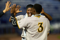 Bradenton Marauders pitcher Luis Ortiz (41) runs to high five Norkis Marcos (3) after scoring a run during a game against the Dunedin Blue Jays on June 5, 2021 at TD Ballpark in Dunedin, Florida.  (Mike Janes/Four Seam Images)
