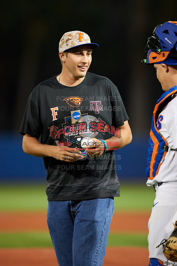 Florida Gators alumni Alex Faedo talks with catcher JJ Schwarz after throwing out the ceremonial first pitch before a game against the Siena Saints on February 16, 2018 at Alfred A. McKethan Stadium in Gainesville, Florida.  Florida defeated Siena 7-1.  (Mike Janes/Four Seam Images)