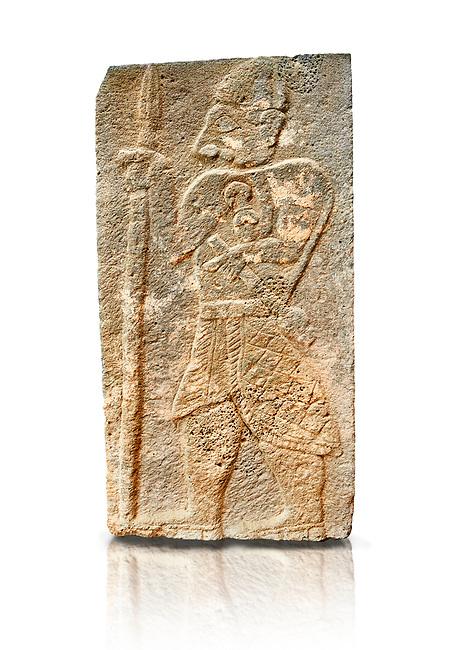 Pictures & images of the North Gate Hittite sculpture stele depicting a God with a spear. 8the century BC.  Karatepe Aslantas Open-Air Museum (Karatepe-Aslantaş Açık Hava Müzesi), Osmaniye Province, Turkey. Against white background