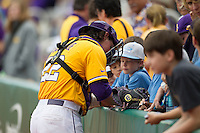 LSU Tigers catcher Kade Scivicque (22) signs autographs before the Southeastern Conference baseball game against the Texas A&M Aggies on April 25, 2015 at Alex Box Stadium in Baton Rouge, Louisiana. Texas A&M defeated LSU 6-2. (Andrew Woolley/Four Seam Images)
