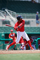 GCL Red Sox designated hitter Antoni Flores (19) swings at a pitch during a game against the GCL Rays on August 1, 2018 at JetBlue Park in Fort Myers, Florida.  GCL Red Sox defeated GCL Rays 5-1 in a rain shortened game.  (Mike Janes/Four Seam Images)