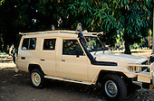 Bujumbura, Burundi. Zanbro four wheel drive vehicle beneath a mango tree with monkeys on the roof.
