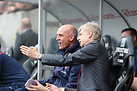 Saturday 28 September 2013<br /> Pictured: Arsenal manager Arsene Wenger (R)<br /> Re: Barclay's Premier League, Swansea City FC v Arsenal at the Liberty Stadium, south Wales.