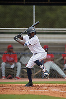 GCL Yankees East D'Vaughn Knowles (4) bats during a Gulf Coast League game against the GCL Phillies West on July 26, 2019 at the New York Yankees Minor League Complex in Tampa, Florida.  (Mike Janes/Four Seam Images)