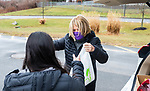 WATERTOWN, CT-011621JS04- Sandy Borden, Interact Chairperson advisor with the Waetrtown Rotary Club, drops off  food items to members of the Watertown High School Interact Club during a food drive Saturday at the high school. All food, personal items and donations will benefit  Safe Haven of Waterbury. The club, which usually holds a pajama collection drive, held the food drive due to COVID restriction on clothing donations. <br /> Jim Shannon Republican-American