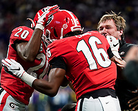 ATLANTA, GA - DECEMBER 7: Lewis Cine #16 and J.R. Reed of the Georgia Bulldogs celebrate with head coach Kirby Smart of the Georgia Bulldogs during a game between Georgia Bulldogs and LSU Tigers at Mercedes Benz Stadium on December 7, 2019 in Atlanta, Georgia.