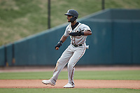 Liover Peguero (10) of the Greensboro Grasshoppers takes his lead off of second base against the Winston-Salem Dash at Truist Stadium on June 19, 2021 in Winston-Salem, North Carolina. (Brian Westerholt/Four Seam Images)