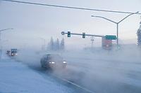 Vehicle traffic on College Road in Fairbanks, Alaska in minus 47 degree temperatures.