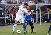 Pedro Leon (left) battles against Adolfo Rosinei (right). Real Madrid defeated Club America 3-2 at Candlestick Park in San Francisco, California on August 4th, 2010.