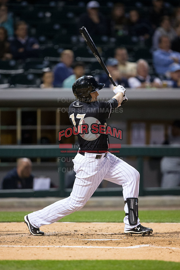 Jason Coats (17) of the Charlotte Knights follows through on his swing against the Toledo Mud Hens at BB&T BallPark on April 27, 2015 in Charlotte, North Carolina.  The Knights defeated the Mud Hens 7-6 in 10 innings.   (Brian Westerholt/Four Seam Images)