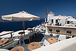 Inviting cafe in Oia, Santorini near classic Windmill