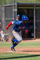 Texas Rangers outfielder Eric Jenkins (92) hustles down the first base line during an Instructional League game against the San Diego Padres on September 20, 2017 at Peoria Sports Complex in Peoria, Arizona. (Zachary Lucy/Four Seam Images)