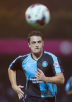 Stephen McGinn of Wycombe Wanderers chases down the ball during the Capital One Cup match between Wycombe Wanderers and Fulham at Adams Park, High Wycombe, England on 11 August 2015. Photo by Andy Rowland.