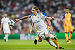 Luka Modric (l) of Real Madrid fights for the ball with Jesus Rueda of APOEL FC during the UEFA Champions League 2017-18 match between Real Madrid and APOEL FC at Estadio Santiago Bernabeu on 13 September 2017 in Madrid, Spain. Photo by Diego Gonzalez / Power Sport Images