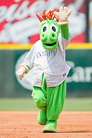 """Charlotte Knights mascot """"Homer the Dragon"""" waves to fans as he runs the bases at Knights Stadium August 8, 2010, in Fort Mill, South Carolina.  Photo by Brian Westerholt / Four Seam Images"""