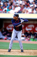 OAKLAND, CA - Roberto Alomar of the Cleveland Indians bats during a game against the Oakland Athletics at the Oakland Coliseum in Oakland, California on April 12, 2000. Photo by Brad Mangin