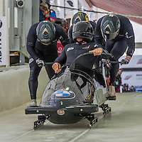 9 January 2016: United Kingdom pilot John James Jackson leads his 4-man team as they push off their first run of the day at the BMW IBSF World Cup Bobsled Championships at the Olympic Sports Track in Lake Placid, New York, USA. Jackson's team came in 16th for the day, with a 2-run combined time of 1:51.80. Mandatory Credit: Ed Wolfstein Photo *** RAW (NEF) Image File Available ***
