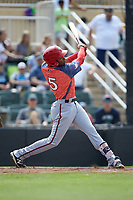 Yasel Antuna (5) of the Hagerstown Suns follows through on his swing against the Kannapolis Intimidators at Kannapolis Intimidators Stadium on May 6, 2018 in Kannapolis, North Carolina. The Intimidators defeated the Suns 4-3. (Brian Westerholt/Four Seam Images)