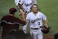 Center fielder Tanner English (3) of the South Carolina Gamecocks is congratulated after scoring a run in an NCAA Division I Baseball Regional Tournament game against the Campbell Camels on Friday, May 30, 2014, at Carolina Stadium in Columbia, South Carolina. South Carolina won, 5-2. (Tom Priddy/Four Seam Images)