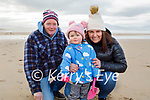 Liam and little Amelia Diggin and Michelle O'Shea enjoying a stroll in Banna beach on Sunday.