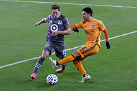 ST PAUL, MN - OCTOBER 18: Memo Rodriguez #8 of Houston Dynamo and Ethan Finlay #13 of Minnesota United FC battle for the ball during a game between Houston Dynamo and Minnesota United FC at Allianz Field on October 18, 2020 in St Paul, Minnesota.