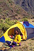 Man camping with tent at Haleakala National park, Maui