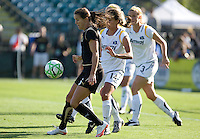 Brandi Chastain (left) controls the ball against Stephanie Cox (14). Los Angeles Sol defeated FC Gold Pride 2-0 at Buck Shaw Stadium in Santa Clara, California on May 24, 2009.